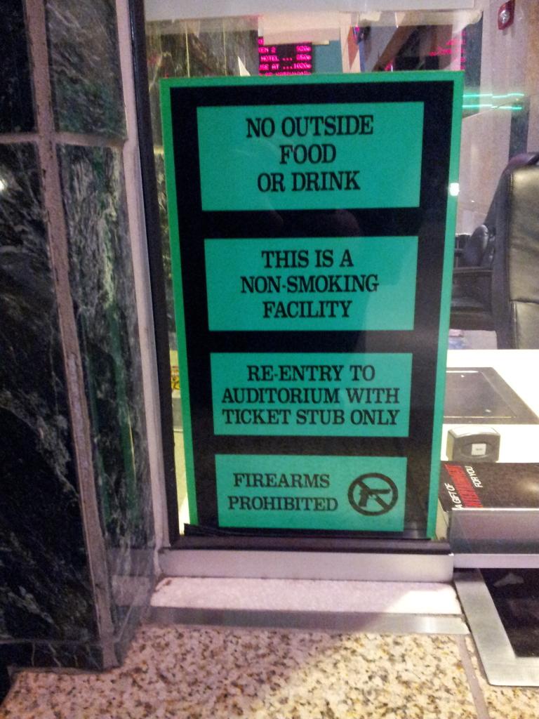 Guns at movie theaters?  Not at Regal